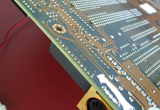 Underside of 486 motherboard showing soldered pins of the RTC chip.
