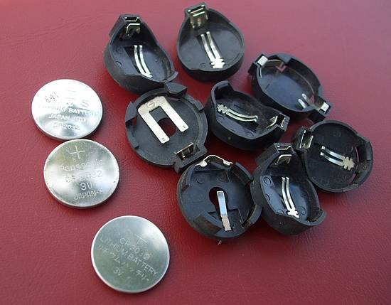 CR2032 button cell and holders recovered from used PC motherboards