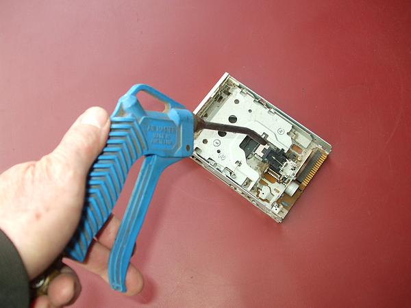 Blowing out dust from floppy disk drive