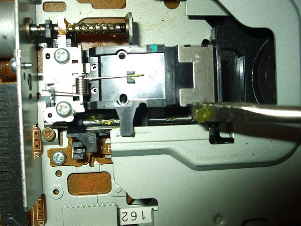 Greasing the floppy drive guide rail